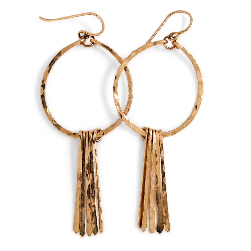 14k gold filled round fringe hoop earrings on a white surface