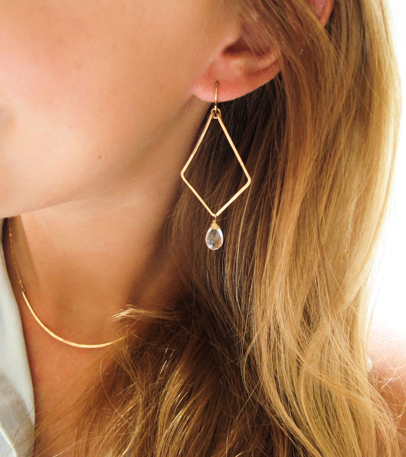 blond woman wearing 14k gold filled crystal quartz arrowhead gemstone earrings