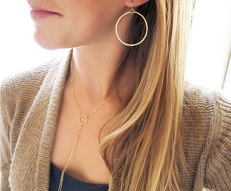 medium sized round hammered gold hoop earrings by delia langan jewelry