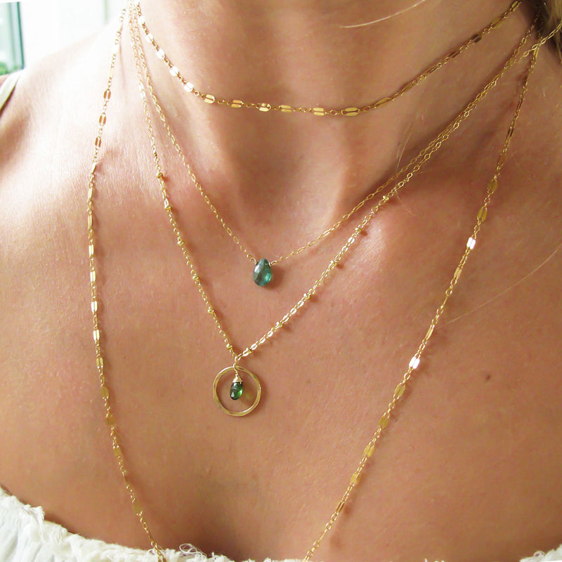 layered gold and green gemstone necklaces