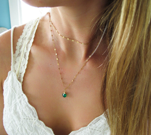 blond woman on a white top wearing a 14k gold filled green onyx 33 inch choker wrap gemstone necklace