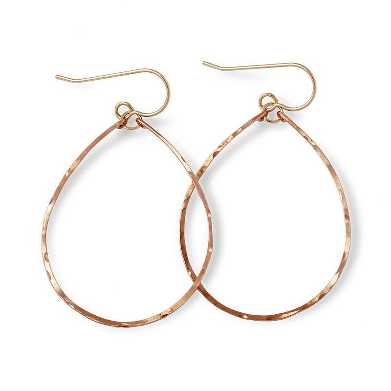 rose gold filled hoops for nuns hoop earrings on a white surface