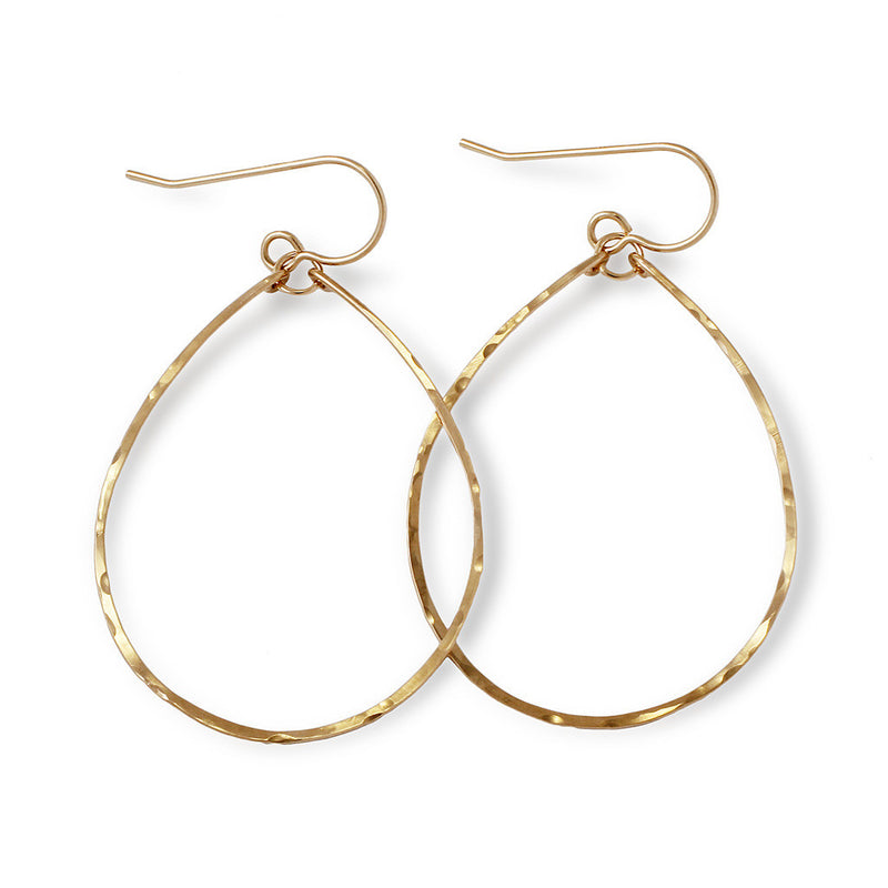 14k gold filled hoops for nuns hoop earrings on a white surface