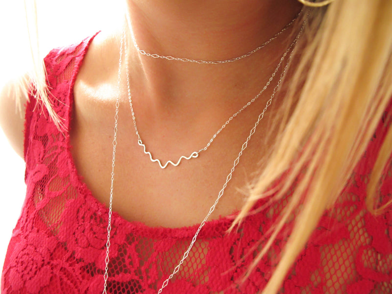 delicate silver wavy necklace layered with silver chain choker delia langan jewelry