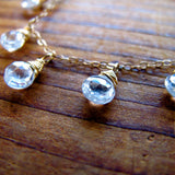 closeup of white topaz and 14k gold filled necklace by delia langan jewelry