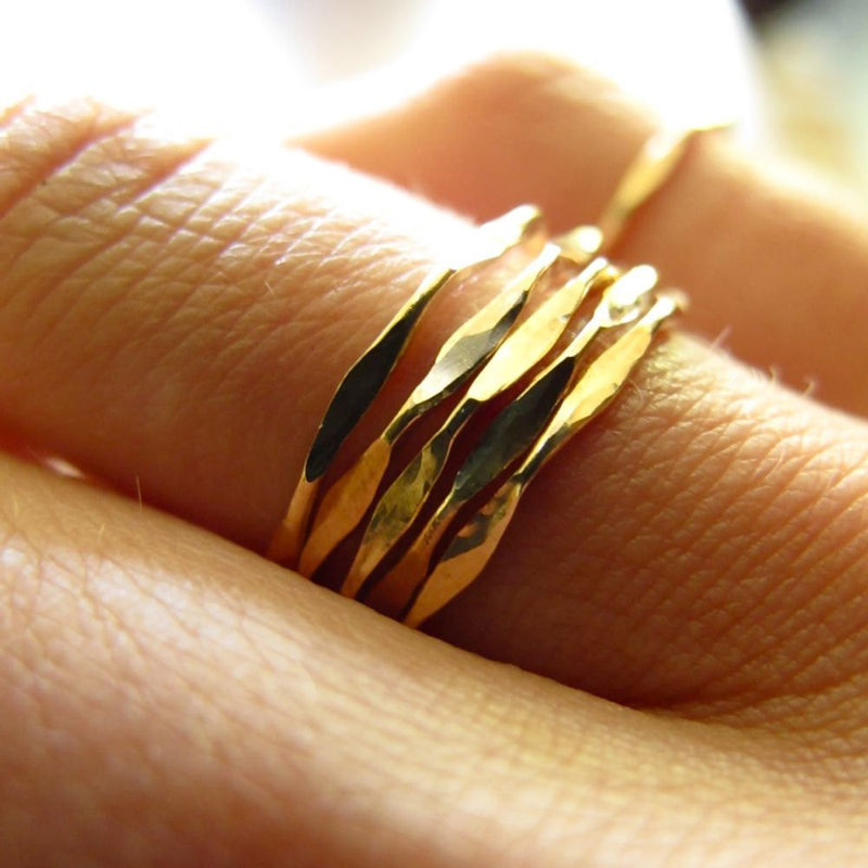 wavy delicate gold stacking rings made by delia langan jewelry