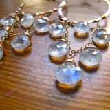 closeup of moonstone and 14k gold filled chandelier earrings by delia langan jewelry