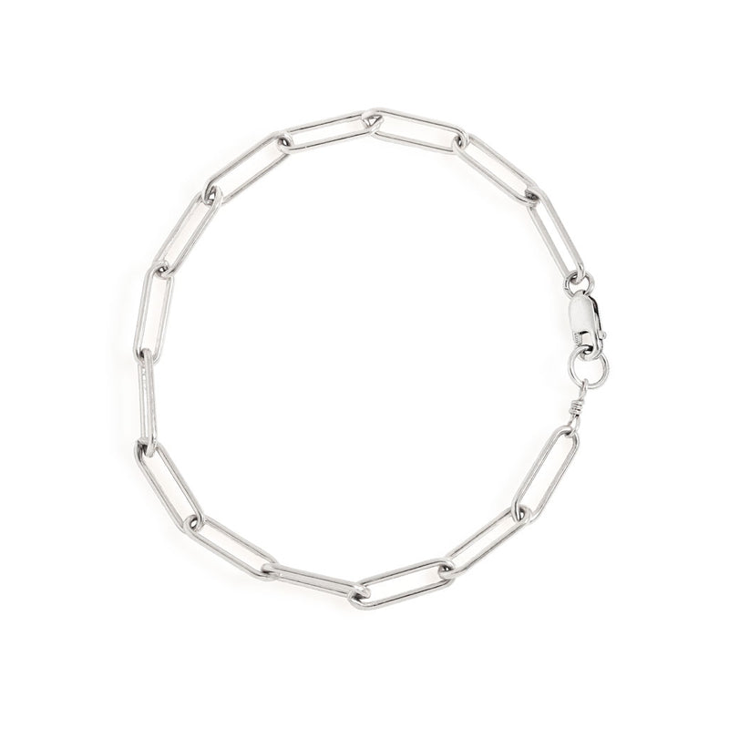 sterling silver large link chain bracelet on white surface