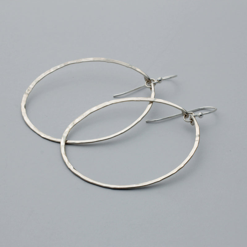 large round sterling silver hoop earrings by delia langan jewelry
