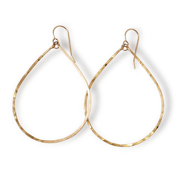 delicate large gold teardrop hoop earrings on white background