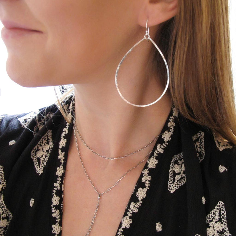 large silver teardrop hoop earrings by delia langan jewelry