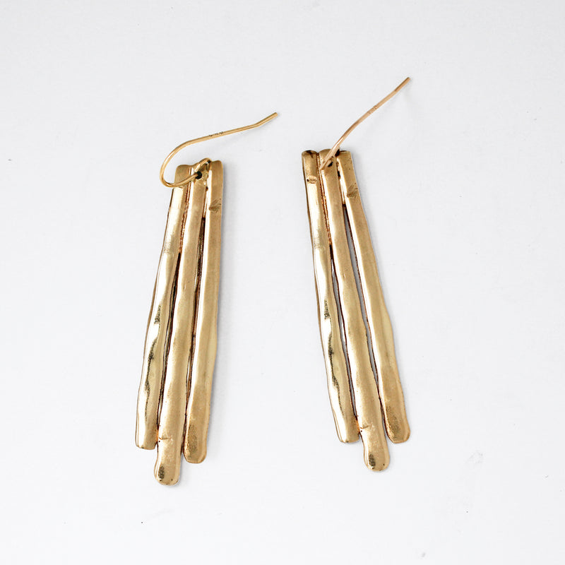 brass with sterling silver posts long fringe post on white surface