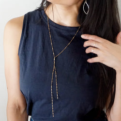 delicate long gold sequin y layering necklace by delia langan jewelry