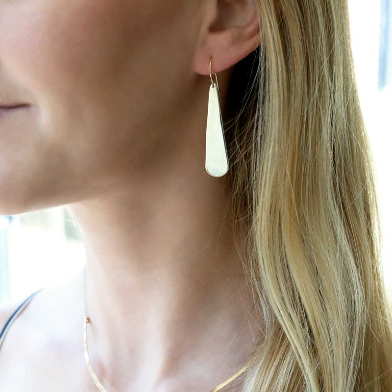 long flat teardrop earrings in gold by delia langan