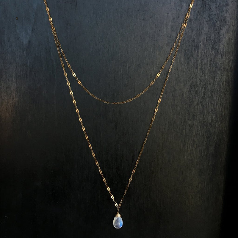 14k gold filled moonstone choker wrap gemstone necklace on a black wood surface