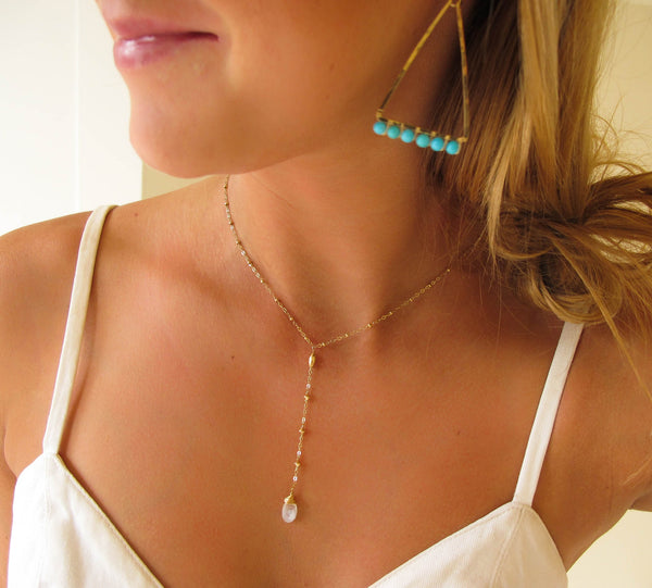blond woman on a white top wearing a 14k gold filled moonstone short y gemstone necklace