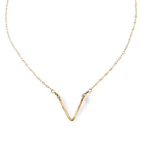 delicate gold v shaped pendant necklace by delia langan jewelry