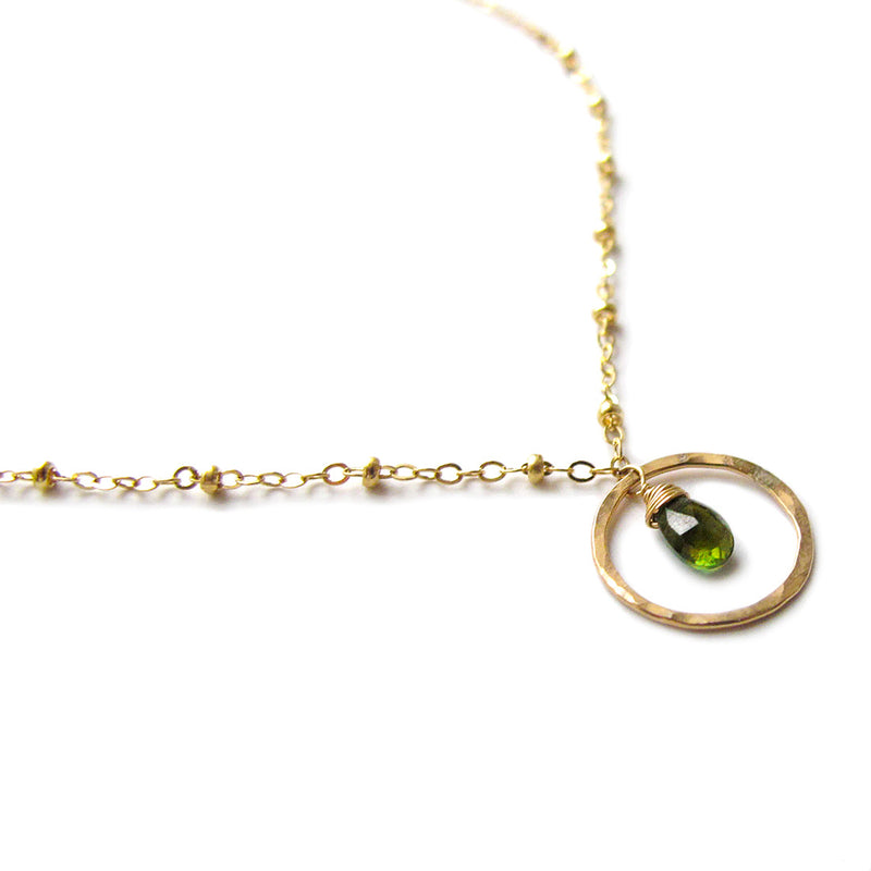 tiny green tourmaline and gold beaded pendant