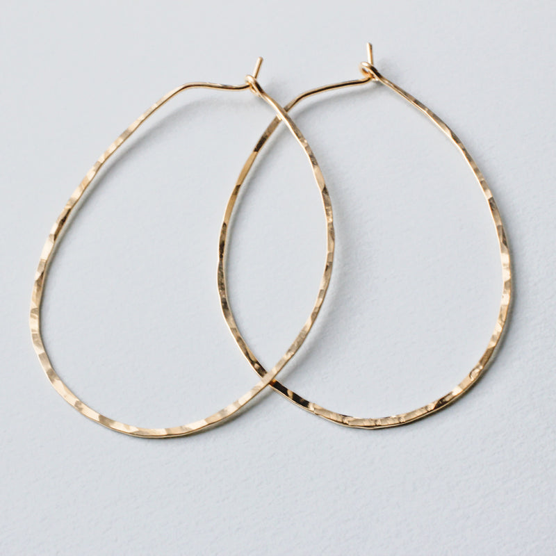thin Oval Hoop Earrings by delia langan jewelry