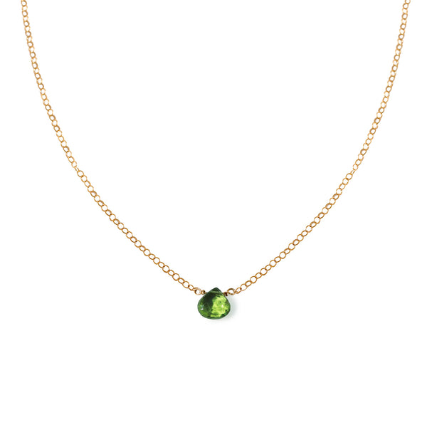 small green peridot pendant on delicate gold chain