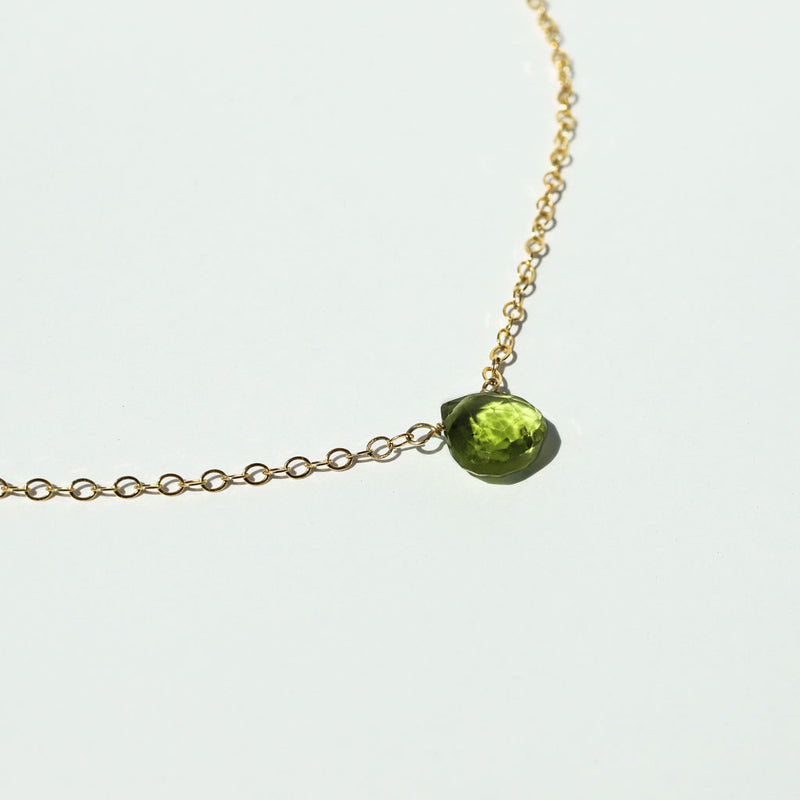dainty green gemstone peridot necklace on gold chain
