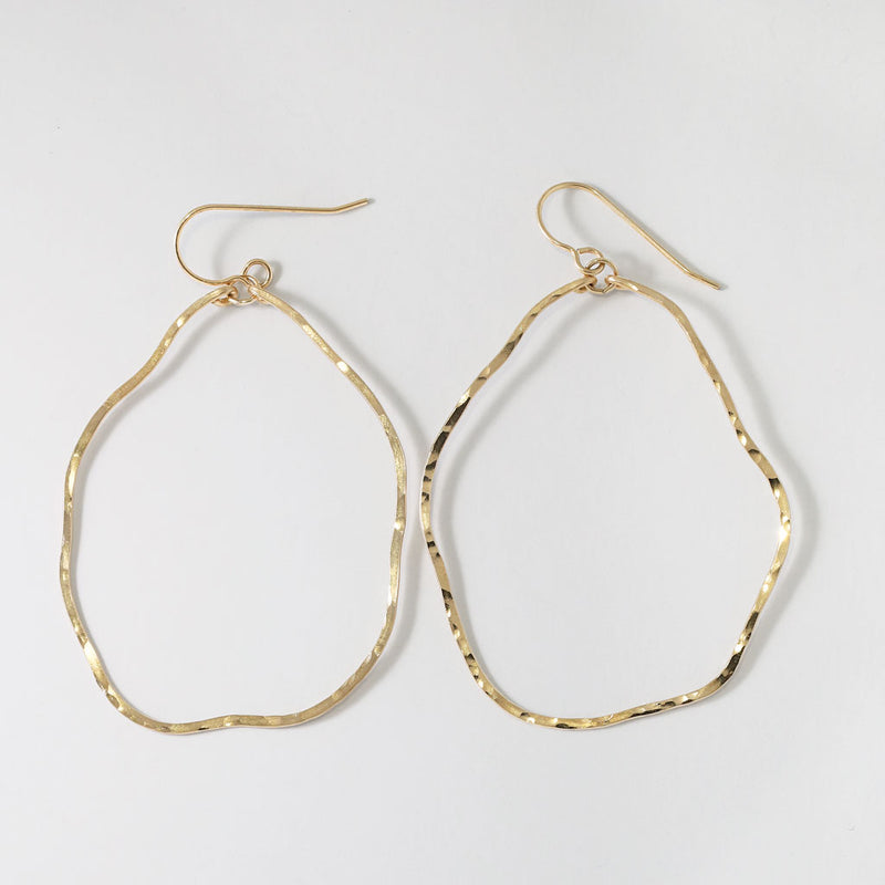 14k gold filled potatohead hoop earrings on a grey surface
