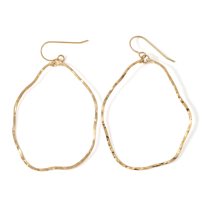 gold wavy irregular hoop earrings hand hammered and handmade by delia langan jewelry