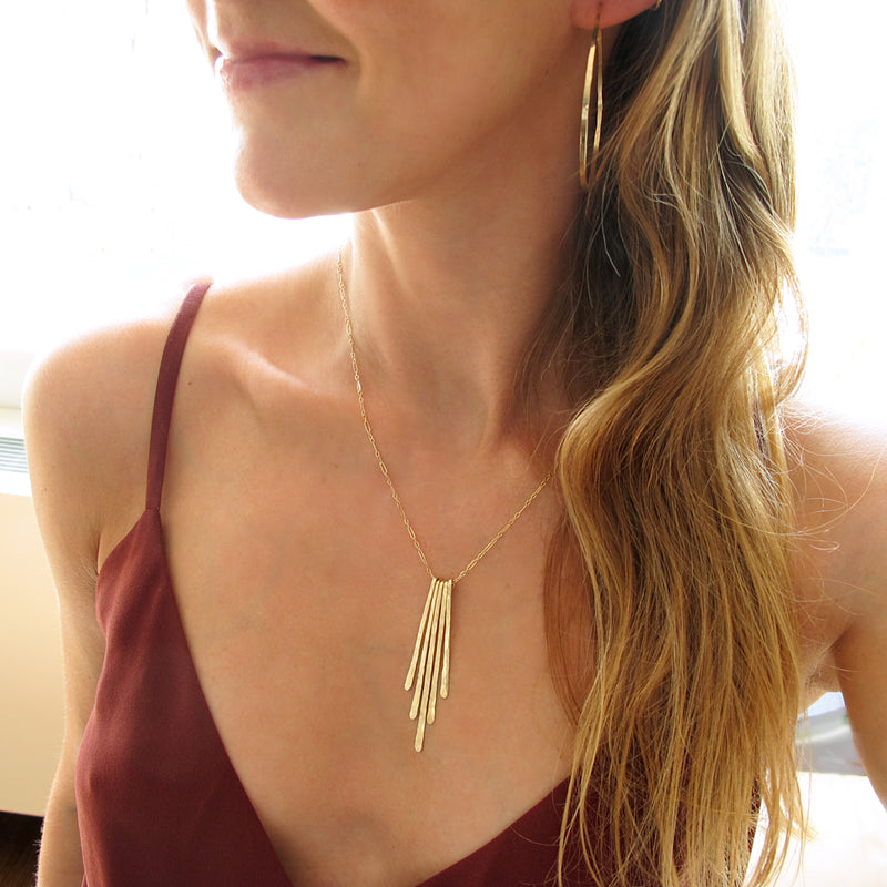 rays pendant gold fringe necklace by delia langan jewelry