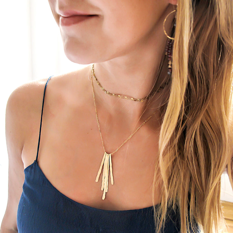 rays pendant gold fringe necklace and gold choker layering necklaces by delia langan jewelry