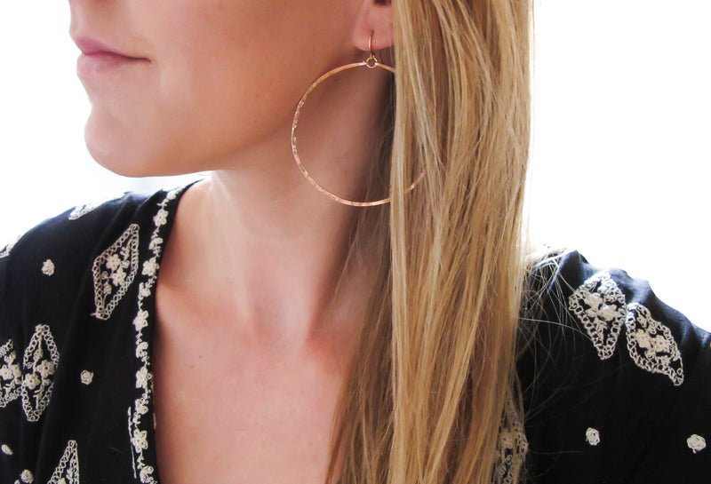 rose gold extra large round hammered hoop earrings handmade jewelry in williamsburg brooklyn by delia langan jewelry