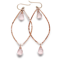 rose quartz rose gold leaf gemstone earrings on a white surface
