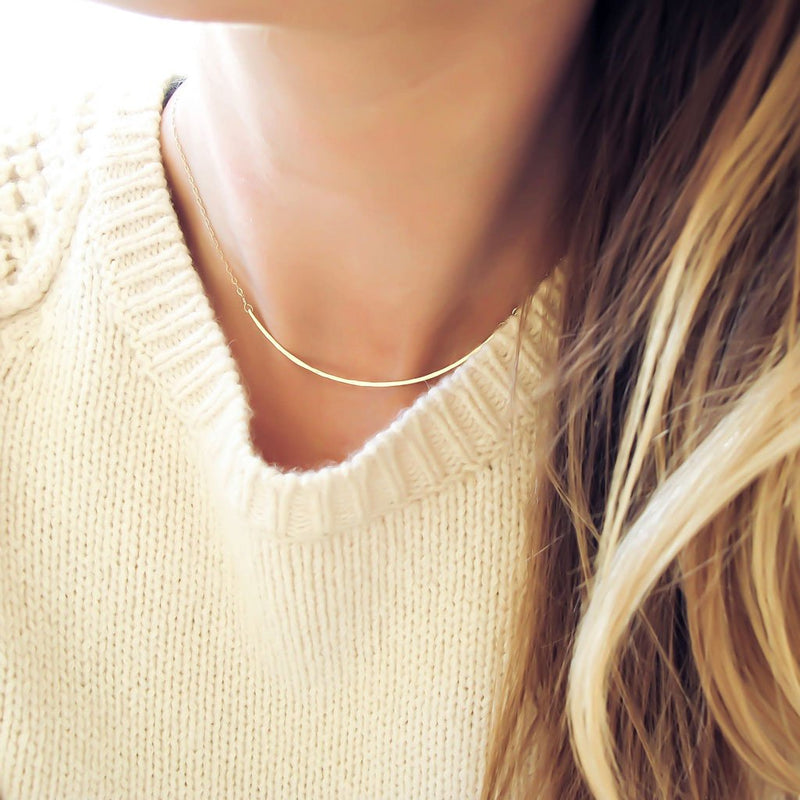 thin gold necklace under cable knit sweater by delia langan jewelry necklace for sweater neckline