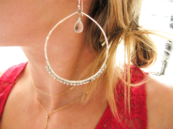 blond woman neck closeup wearing sterling silver silver pyrite and crystal quartz multi gemstone hoop earrings