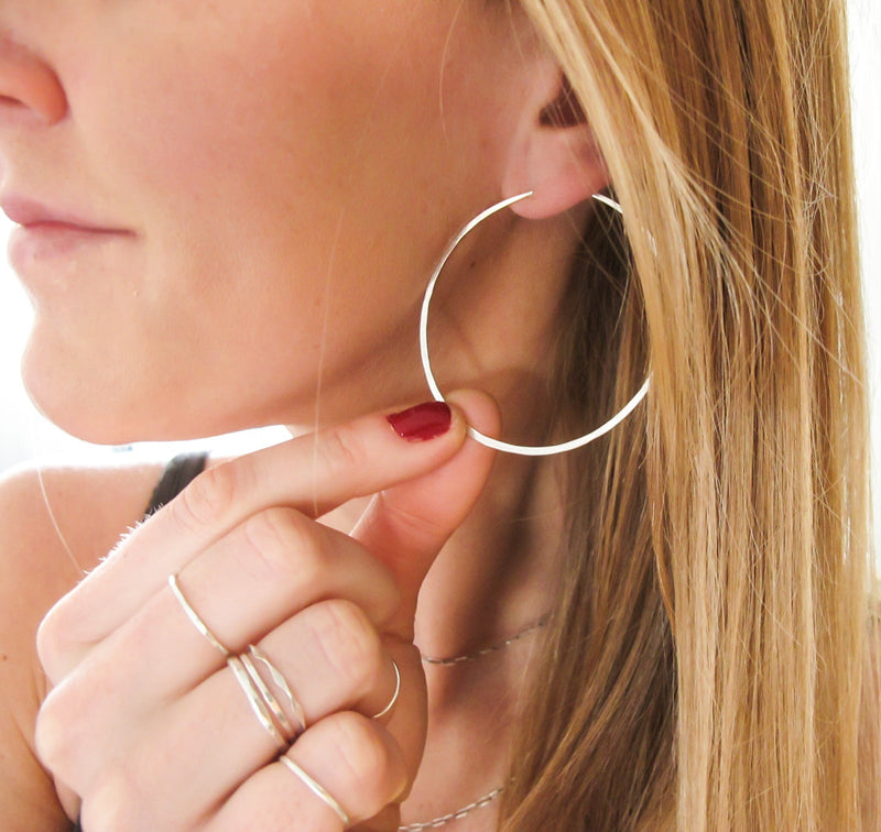 hammered sterling silver hoop earrings by delia langan jewelry