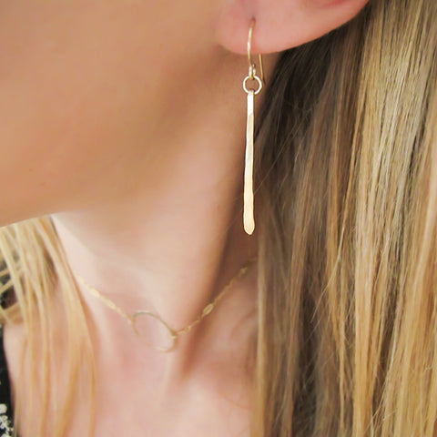 single fringe earring in gold by delia langan jewelry small lightweight gold strip dangle earrings