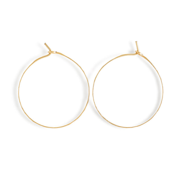 small 14k gold filled horizon endless hoop earrings on white surface
