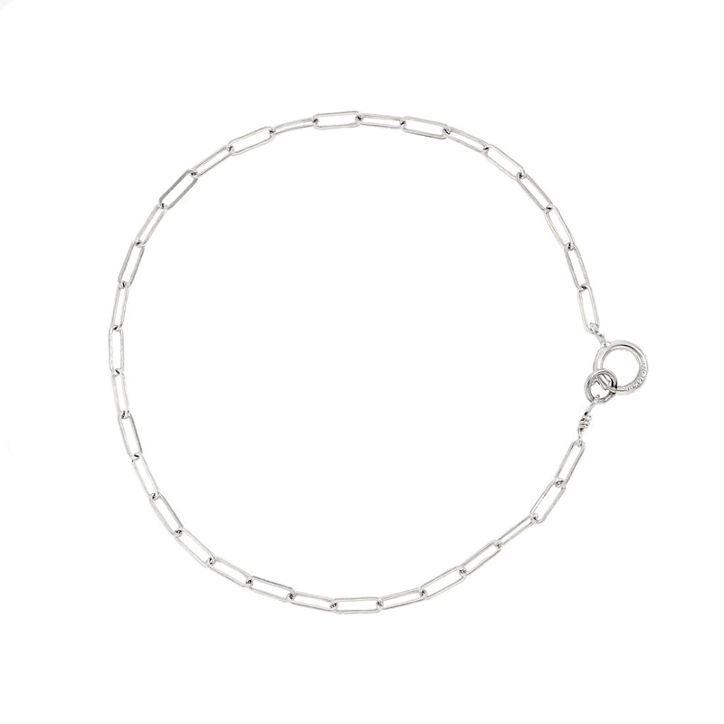 sterling silver small link chain bracelet on white surface