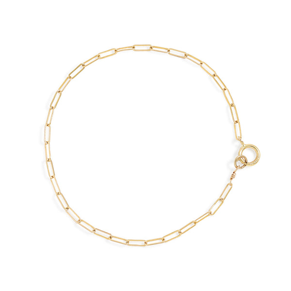gold color small link chain bracelet on white surface