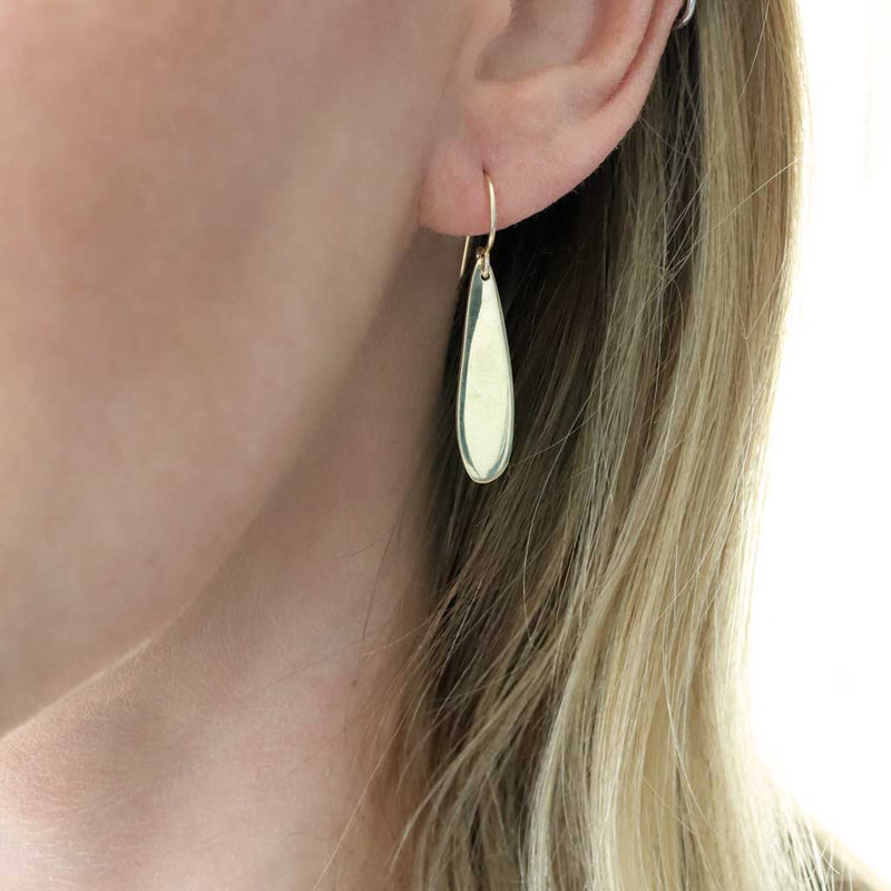 minimalist gold teardrop earrings by delia langan