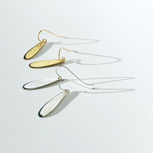 simple gold and silver teardrop earrings by delia langan