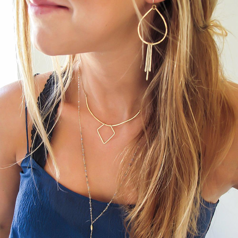 gold geometric necklace layered with labradorite necklace and gold fringe earrings