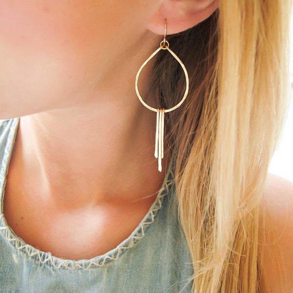 small teardrop fringe earrings with layered necklaces by tahastaffingsolutions