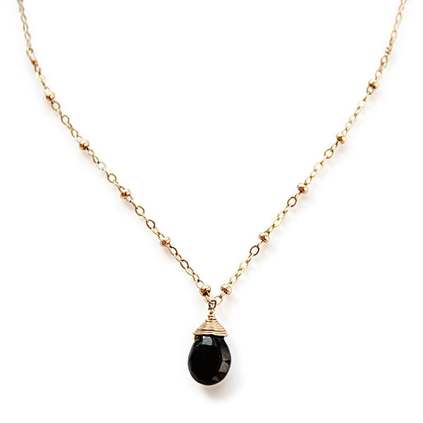 black spinel pendant on beaded gold chain