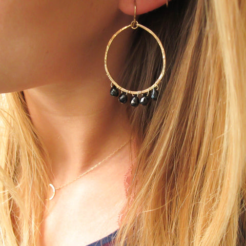 black spinel and 14k gold filled hammered hoop earrings by delia langan jewelery