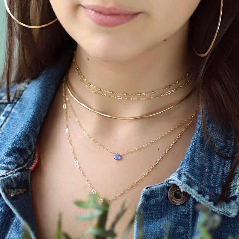 dainty tanzanite pendant and delicate gold layering necklaces
