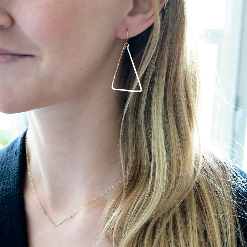 gold triangle dangle earrings delia langan jewelry