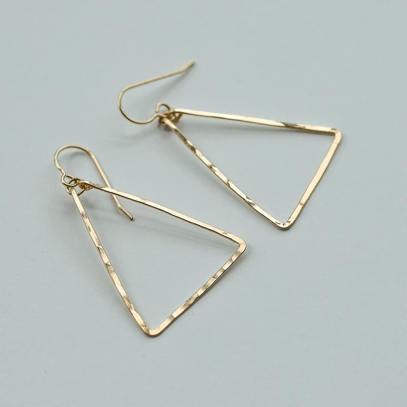 delicate gold triangle earrings by delia langan jewelry