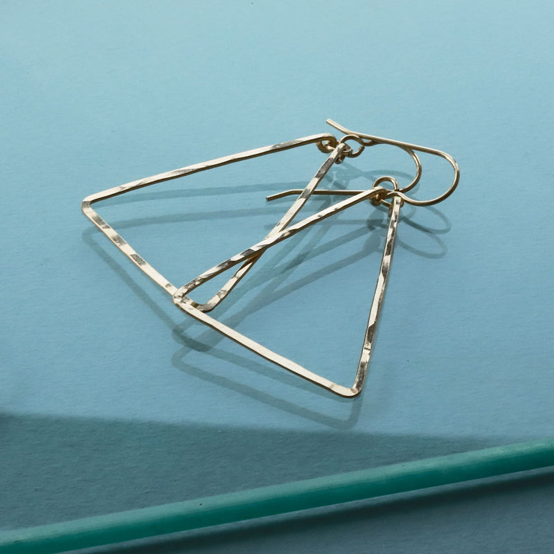 gold triangle earrings by delia langan jewelry