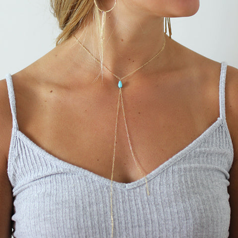 turquoise bolo y necklace on gold chain by delia langan jewelry
