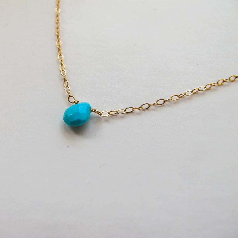 turquoise stone with gold chain